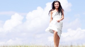 Happy-Girl-In-White-Dress-In-Field